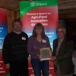 Premier's Award presented to New Terra Farm by local Member of Provincial Parliament