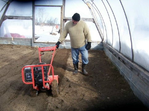 Scott tilling the hoophouse in February